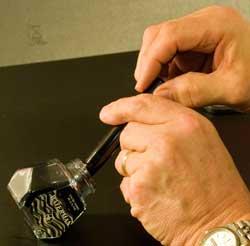 Filling a pen tabkes both hands